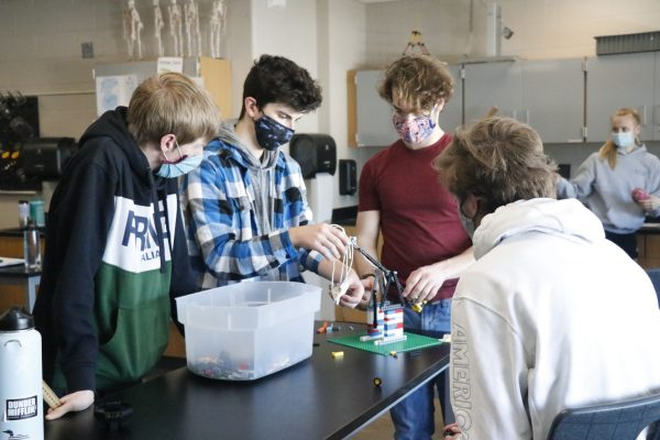 Image of students working on science project