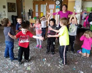 children playing with confetti