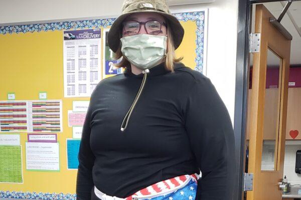 Teacher in fatigues.
